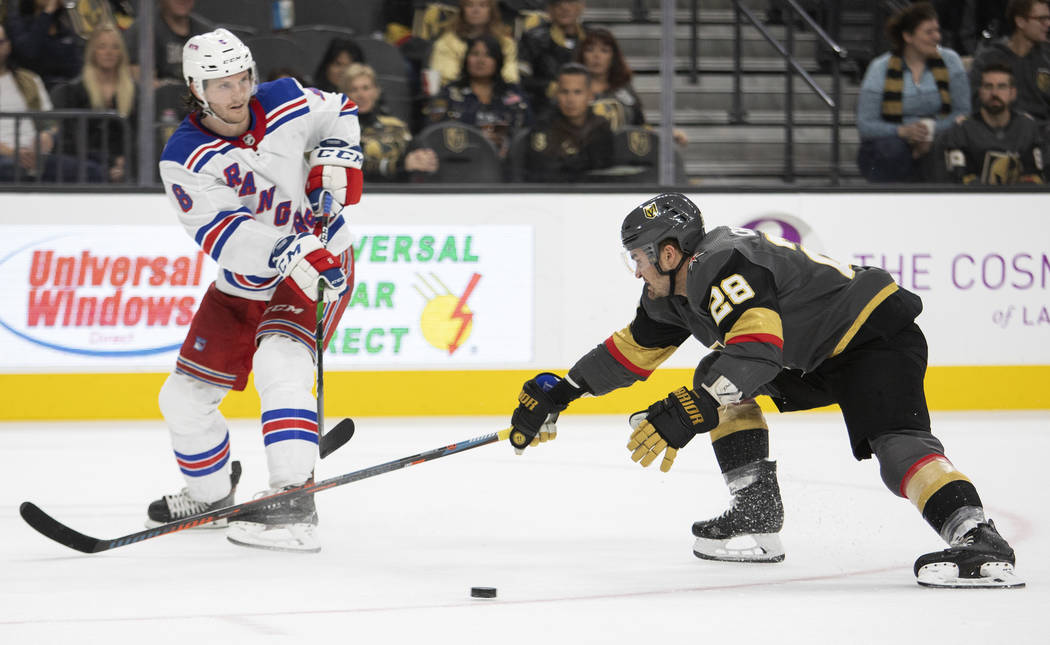 Golden Knights left wing William Carrier (28) reaches to take control of the puck as New York R ...