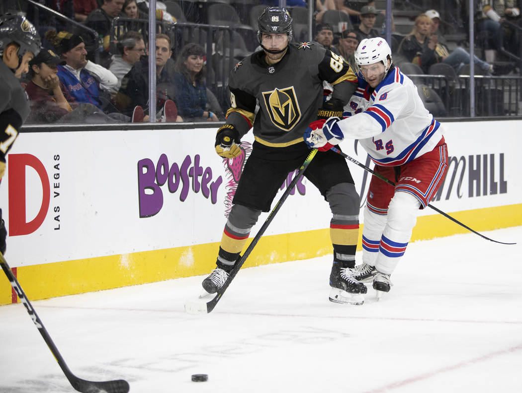 Golden Knights right wing Alex Tuch (89) eyes the puck after passing as New York Rangers defens ...