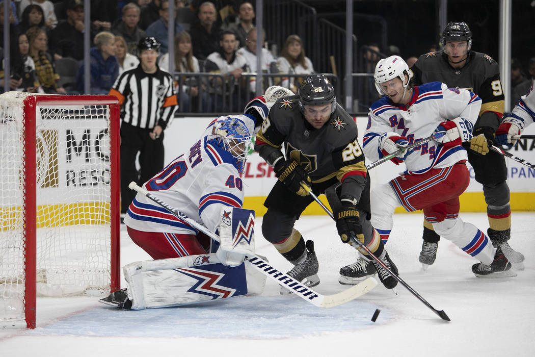 Vegas Golden Knights left wing William Carrier (28) makes an unsuccessful shot on goal as New Y ...