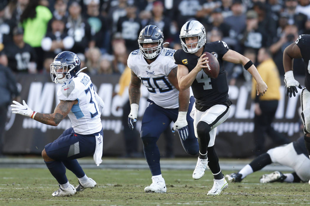 Oakland Raiders quarterback Derek Carr (4) runs against the Tennessee Titans during the second ...