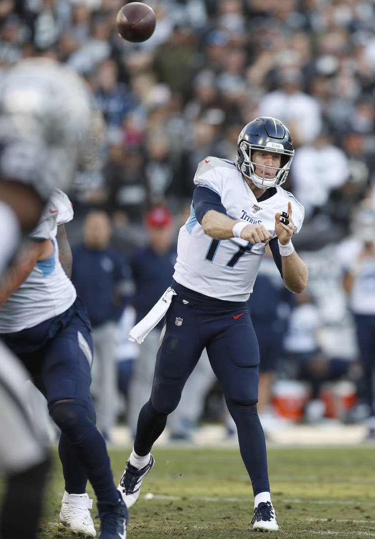 Tennessee Titans quarterback Ryan Tannehill (17) passes against the Oakland Raiders during the ...