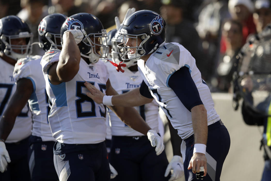 Tennessee Titans quarterback Ryan Tannehill, right, celebrates with teammates after wide receiv ...