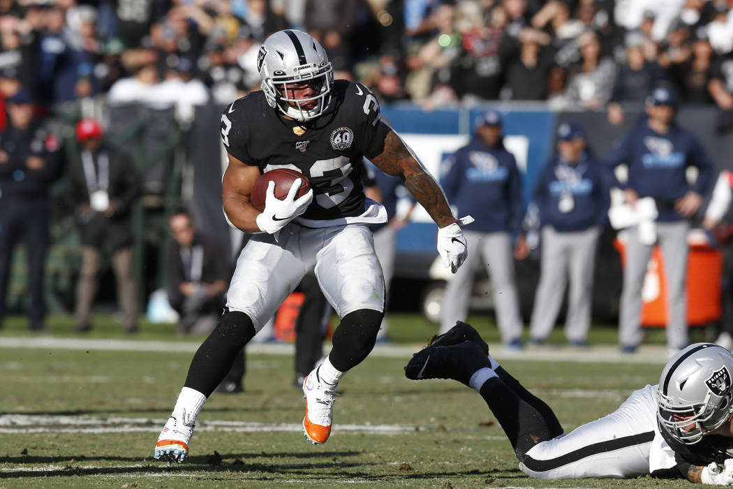 Oakland Raiders running back DeAndre Washington (33) runs against the Tennessee Titans during t ...