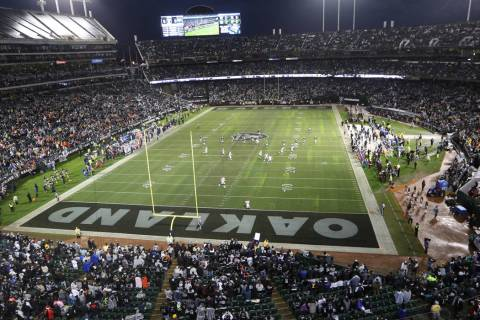 An overview of the Oakland-Alameda County Coliseum before the start of an NFL game between the ...