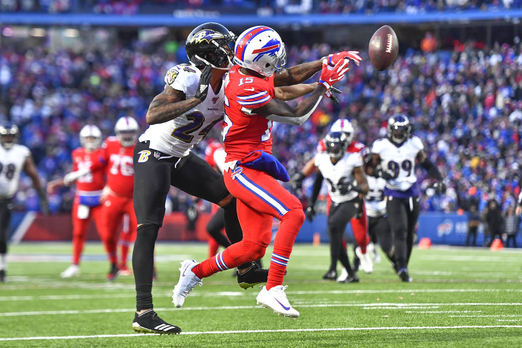 Baltimore Ravens cornerback Marcus Peters (24) breaks up a pass intended for Buffalo Bills wide ...