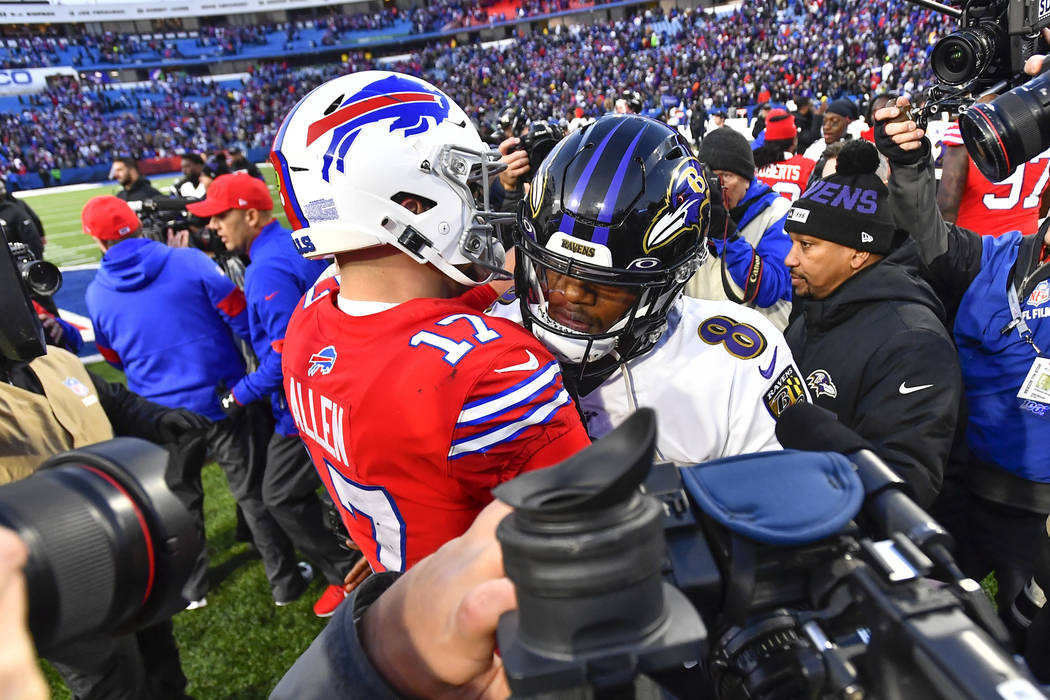 Baltimore Ravens quarterback Lamar Jackson (8) talks with Buffalo Bills quarterback Josh Allen ...