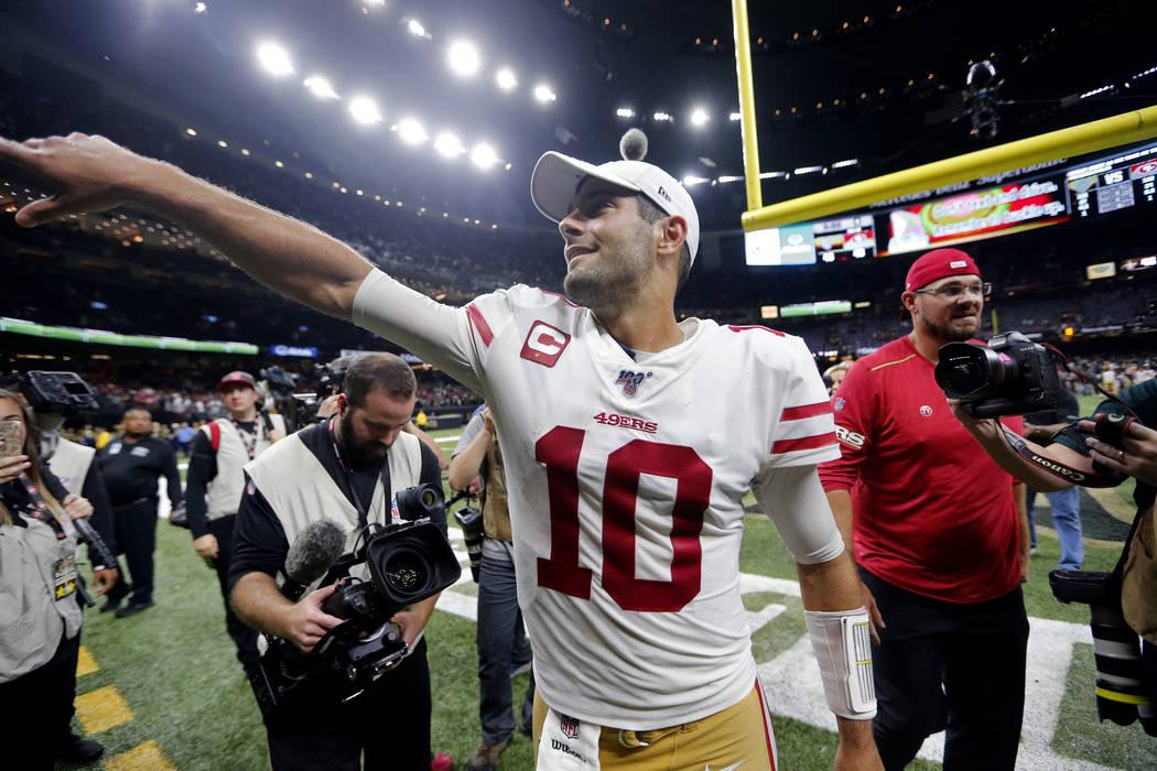 San Francisco 49ers quarterback Jimmy Garoppolo (10) celebrates after an NFL football game agai ...