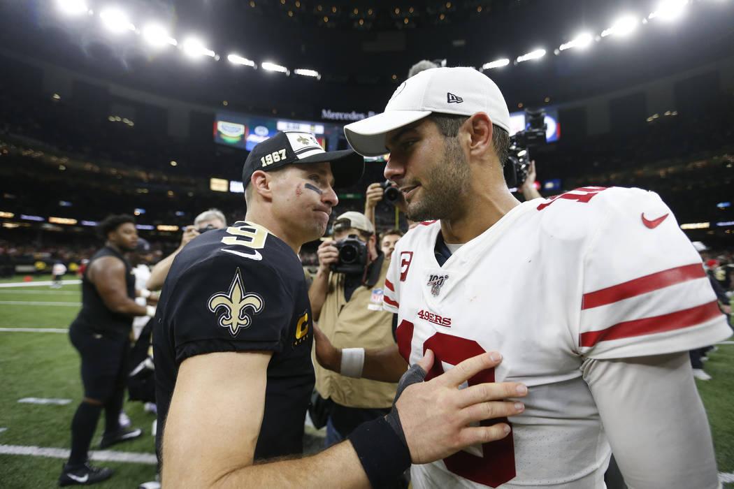 New Orleans Saints quarterback Drew Brees (9) greets San Francisco 49ers quarterback Jimmy Garo ...