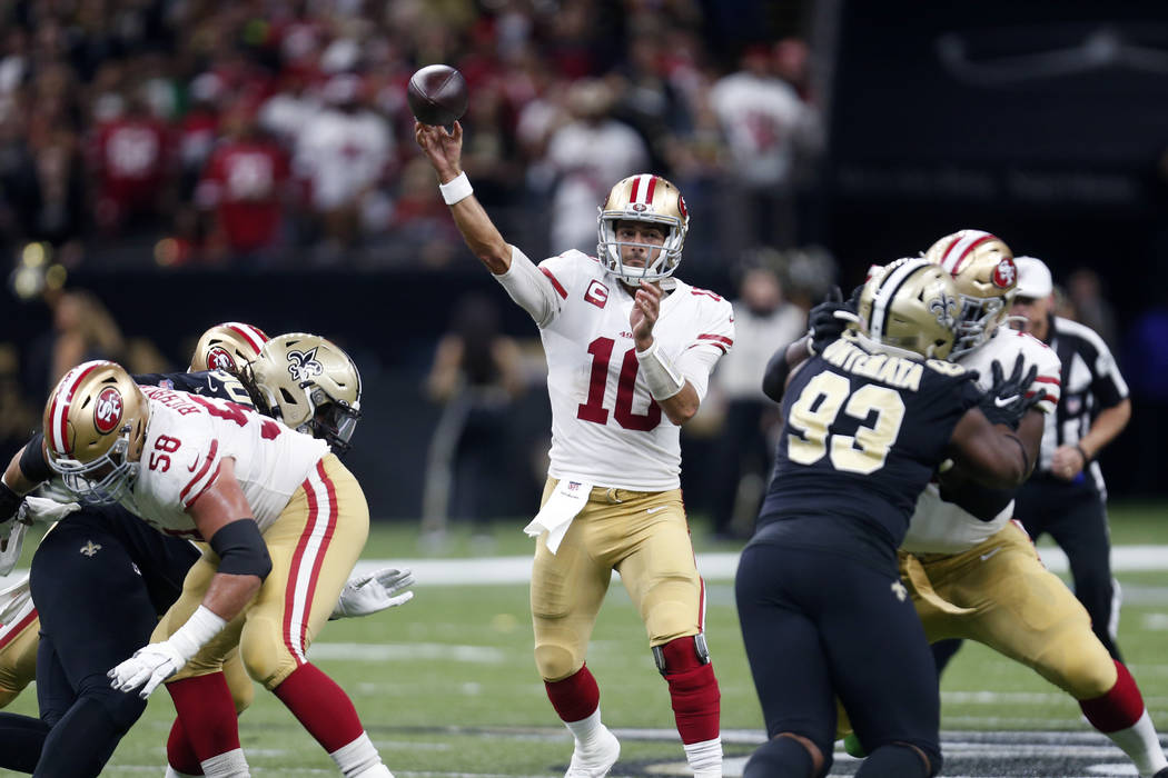 San Francisco 49ers quarterback Jimmy Garoppolo (10) passes in the first half an NFL football g ...