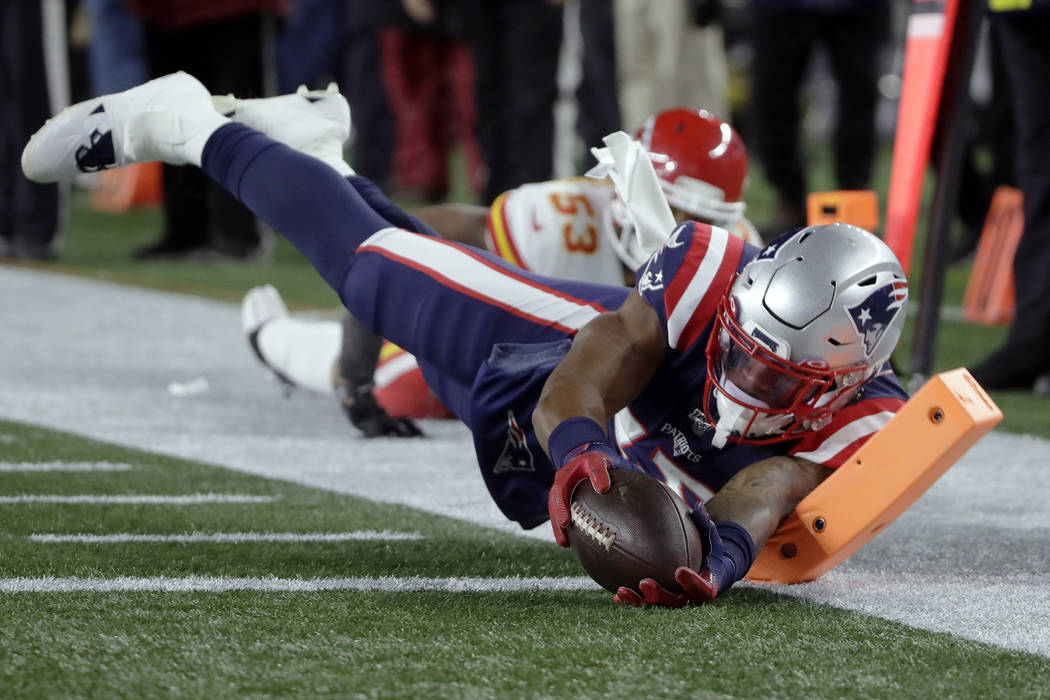 New England Patriots wide receiver N'Keal Harry dives for the pylon after catching a pass again ...