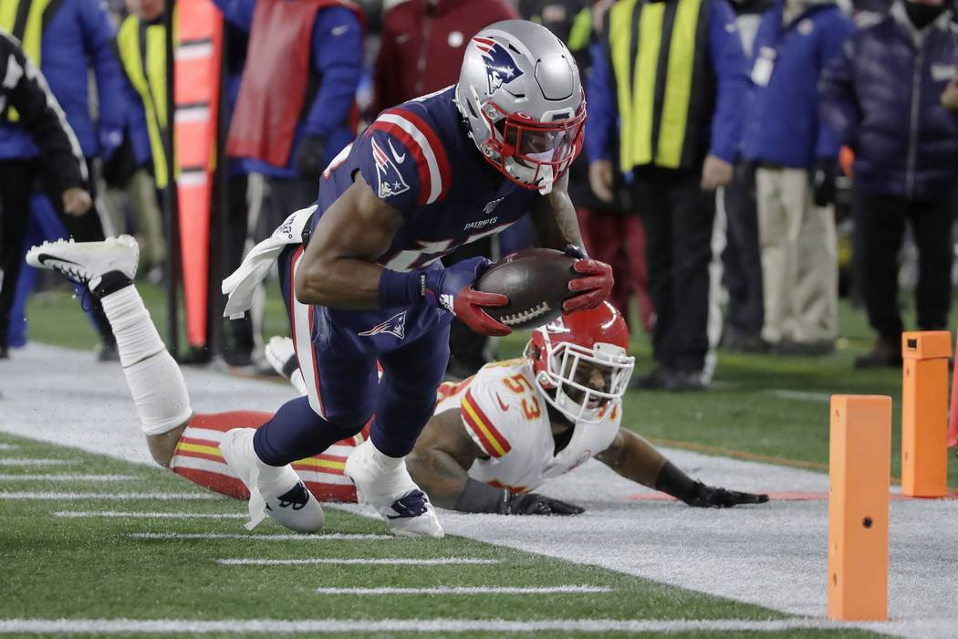 New England Patriots wide receiver N'Keal Harry runs for the goal line after catching a pass ag ...