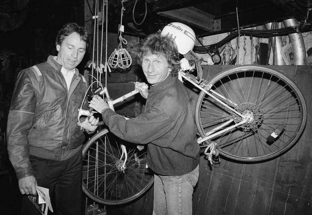 FILE - In this May 16, 1985, file photo, actor John Ritter, left, checks out the bicycle of fel ...