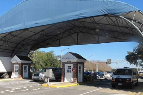 FILE- In this Jan. 29, 2016 file photo shows the entrance to the Naval Air Base Station in Pens ...