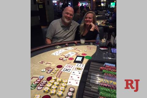 Michael and Elena Barrows of California celebrate Michael's winning Face Up Pai Gow progressive ...