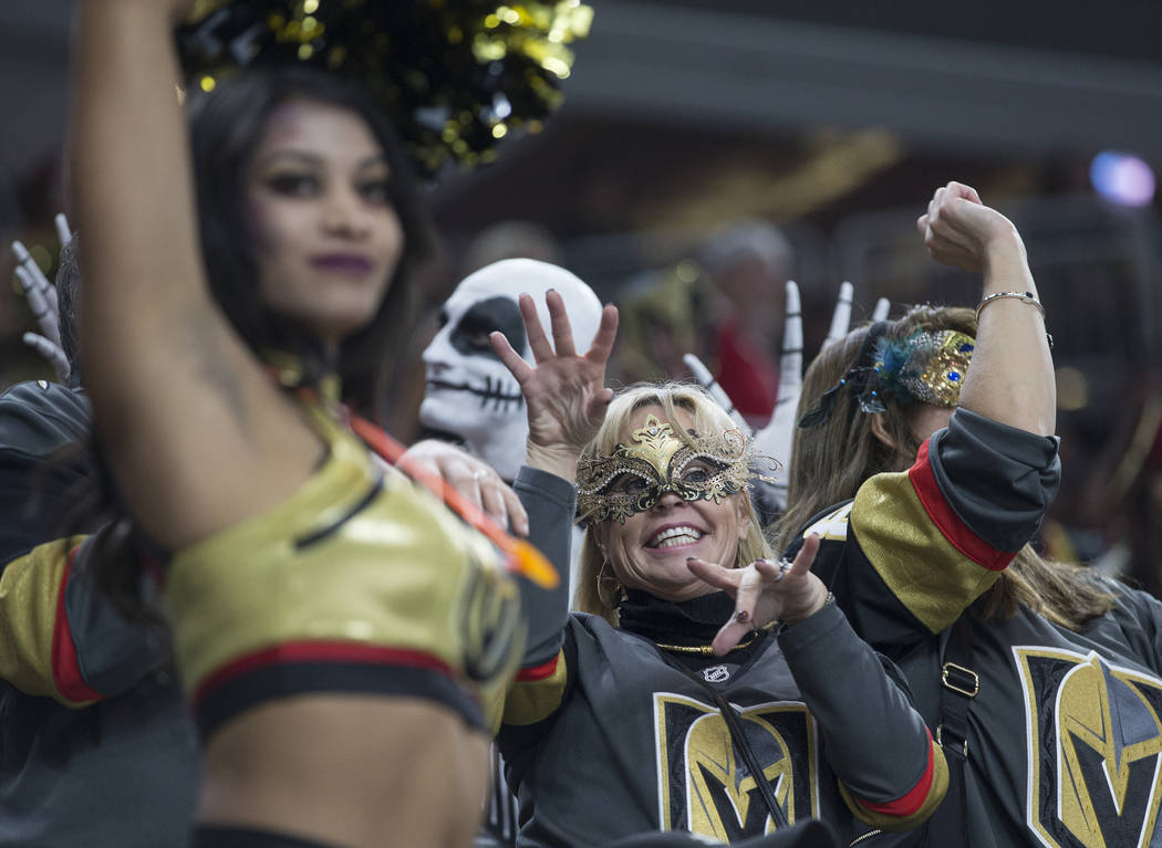 Vegas fans dress up for Halloween at T-Mobile Arena during the Golden Knights NHL hockey game w ...