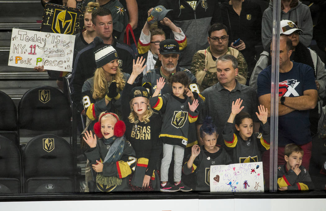 Vegas Golden Knights fans press up to the glass in hopes of getting a puck before the first per ...