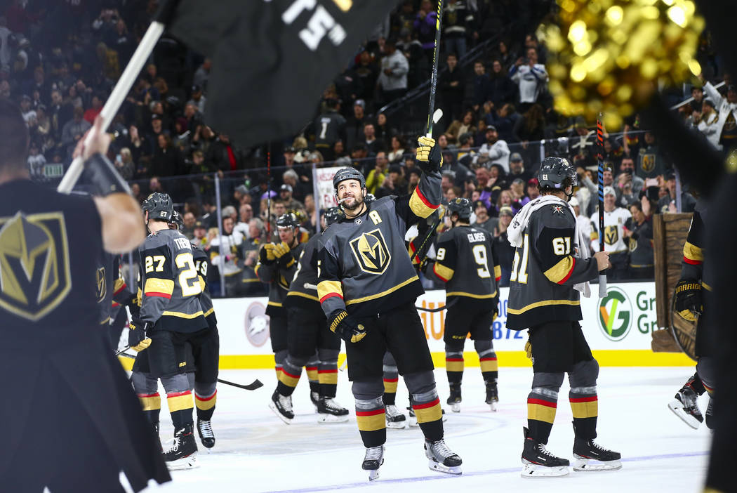 The Golden Knights, including Deryk Engelland, center, celebrate after a shootout win over the ...