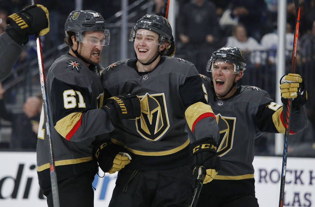 Vegas Golden Knights center Cody Glass, center, celebrates with Mark Stone, left, and Paul Stas ...