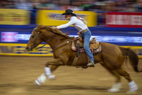 Dona Kay Rule of Minco, Okla., heads home in Barrel Racing during the third go round of the Wra ...