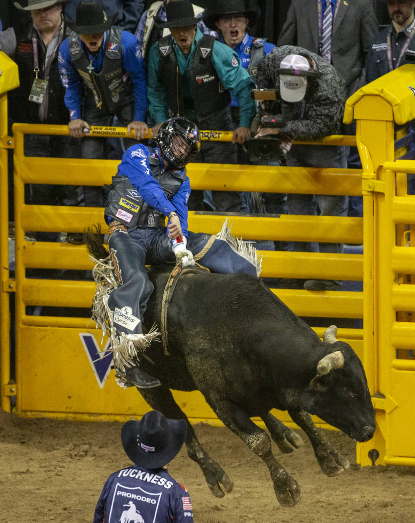 Stetson Wright of Milford, Utah, holds on tight atop Holy Holly for a score of 91.0 points and ...