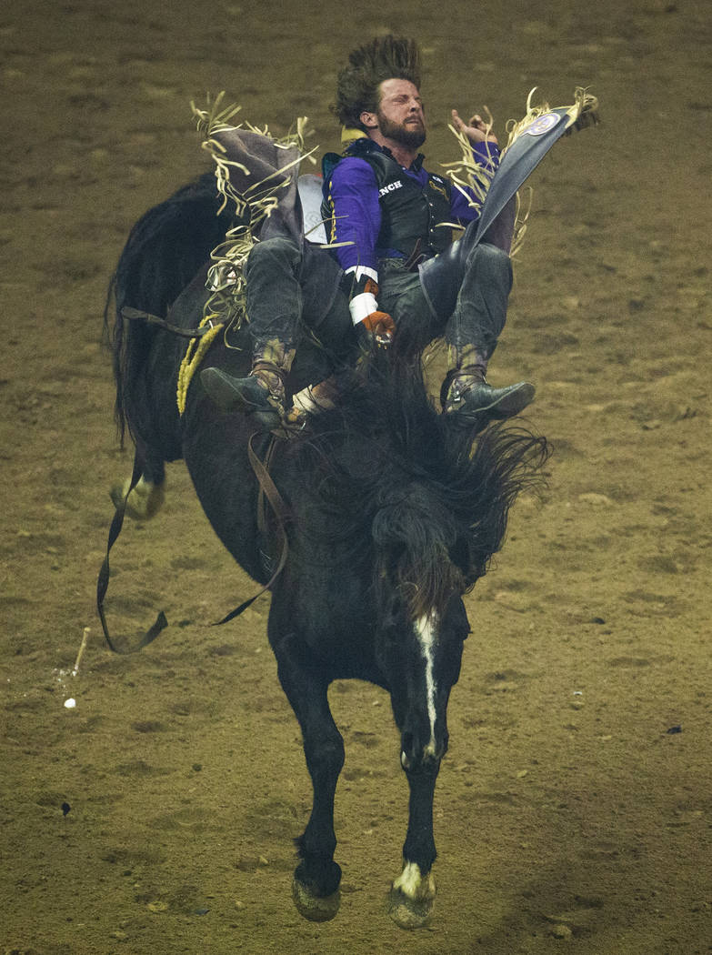 Jake Brown of Cleveland, Texas, rides Ruby's Girl during Bareback Riding in the fourth go round ...