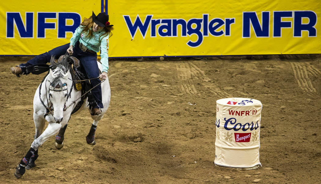 Emily Miller of Weatherford, Okla., turns for home on her way to a time of 13.64 seconds and a ...