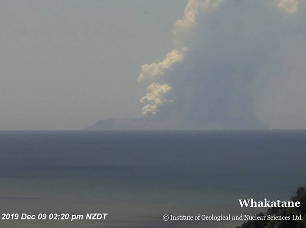 This image released by GNS Science, shows plumes of smoke from a volcanic eruption on White Isl ...