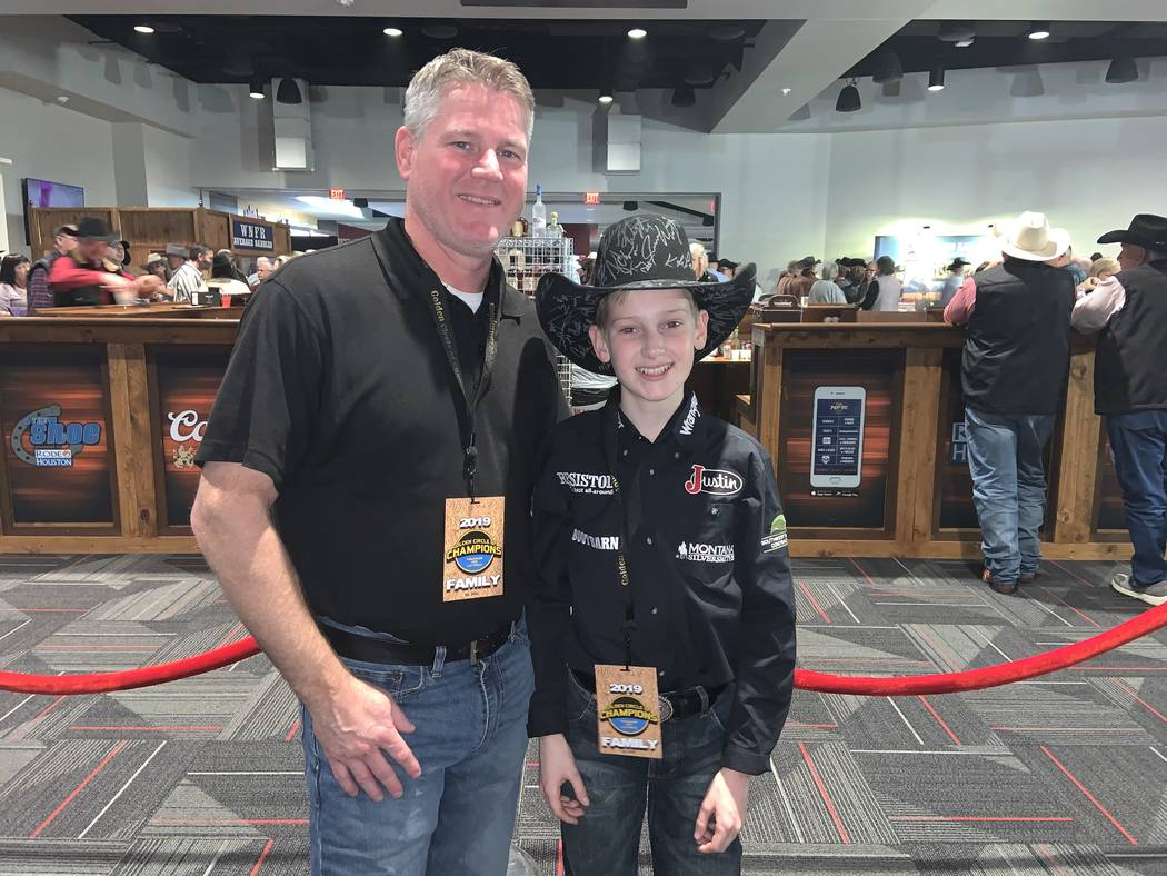 Seth Permenter, with his father Lance Permenter at the Golden Circle of Champions event Sunday, ...