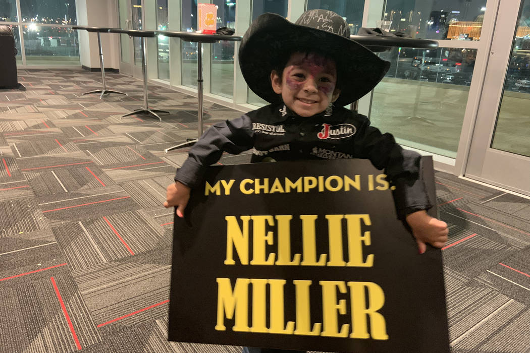 Aryia Ramos shows who she's rooting for -- star barrel racer Nellie Miller -- before Sunday nig ...