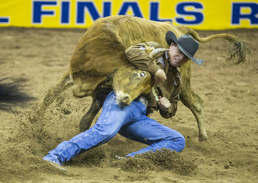 J.D. Struxness of Milan, Minn., places in Steer Wrestling during the third go-around of the Wra ...