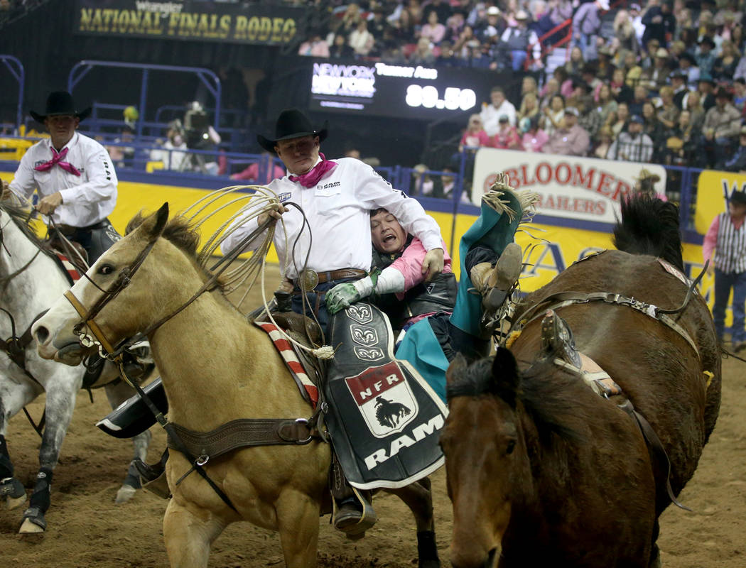 Tanner Aus of Granite Falls, Minn. dismounts Weenie in the bareback competition during the fift ...