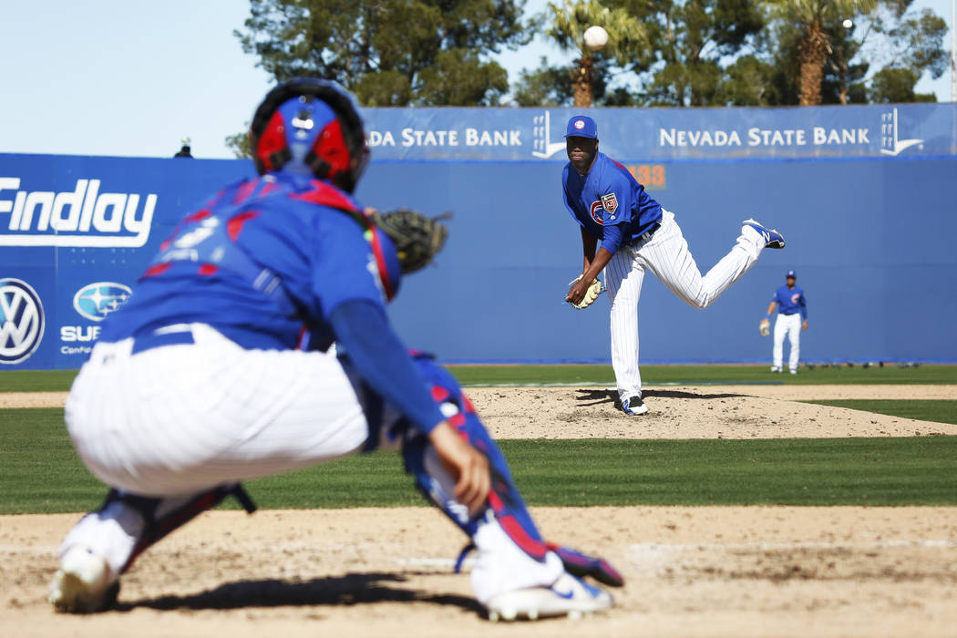 Chicago Cubs' Alberto Baldonado (87) practices his pitches during the annual Big League Weekend ...