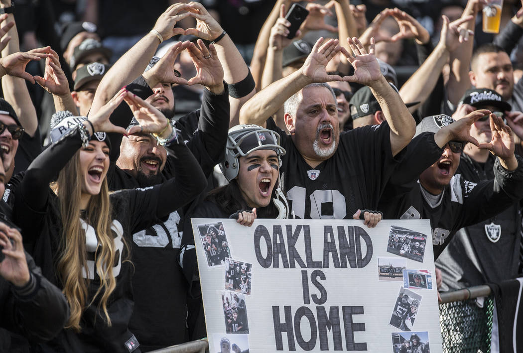 Raiders fans cheer for Oakland during an NFL football game with the Jacksonville Jaguars at the ...