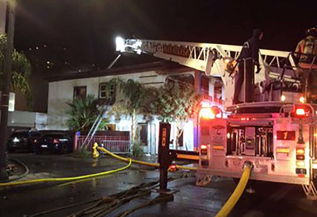 Firefighters battle a two-alarm blaze in a vacant residence at 307 S. Main St. early Monday, De ...