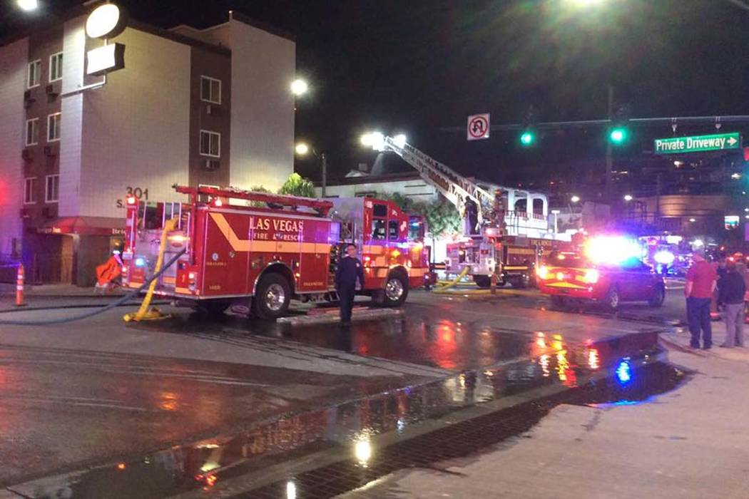 Firefighters battle a two-alarm blaze in a vacant building at 307 S. Main St. early Monday, Dec ...