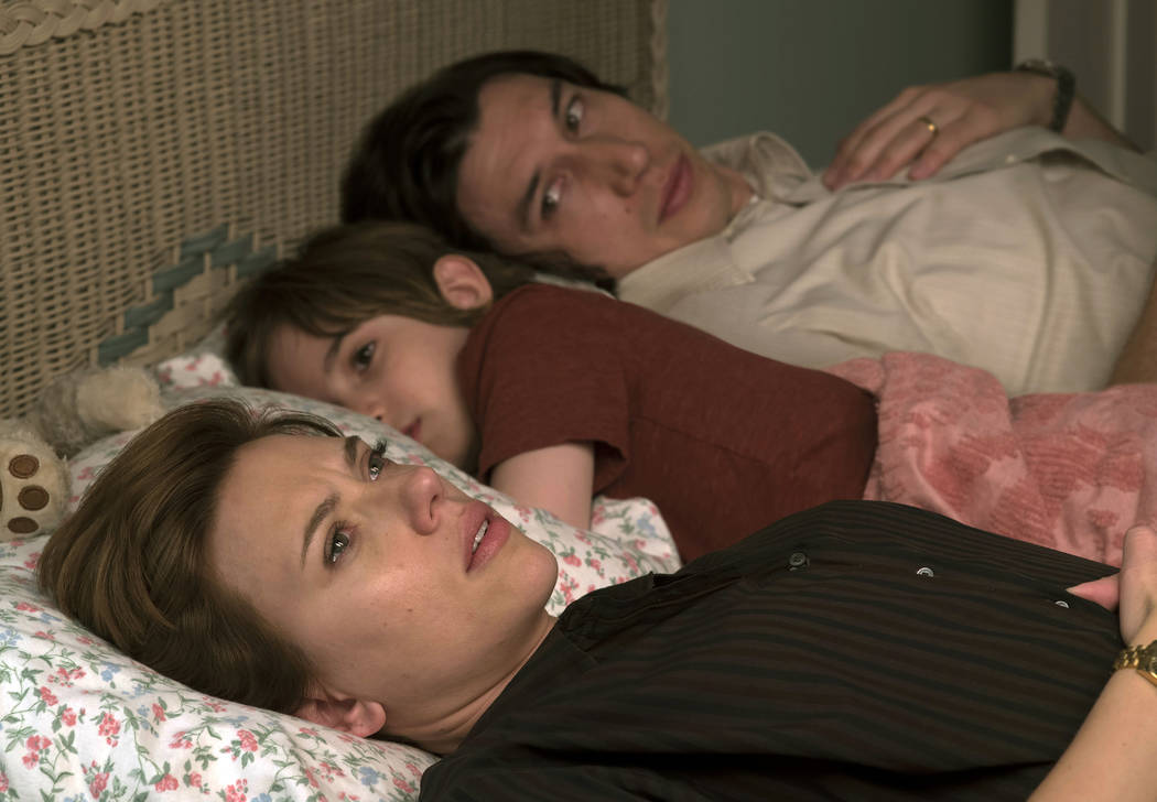 """This image released by Netflix shows Scarlett Johansson, left, and Adam Driver in """"Marriag ..."""