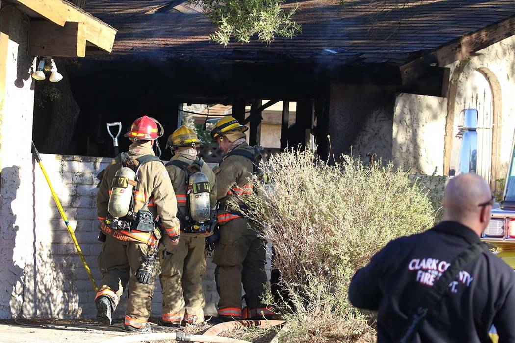 Clark County firefighters battle a house fire at 4860 Plata del Sol Drive on Monday, Dec. 9, 20 ...