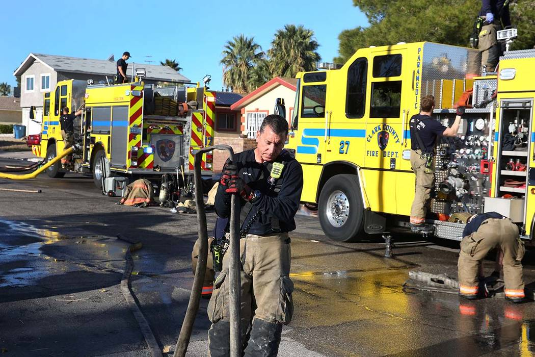 Clark County firefighters prepare to leave after battling a house fire at 4860 Plata del Sol Dr ...