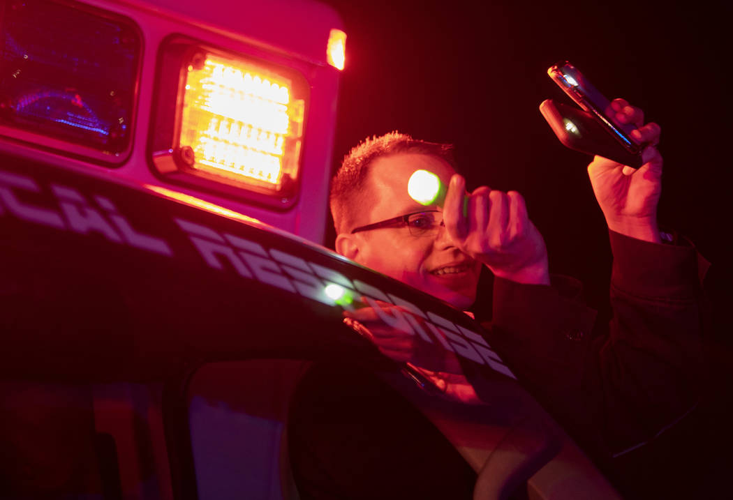MedicWest operations manager Nick Jurman shines three flashlights up to the third floor of UMC ...