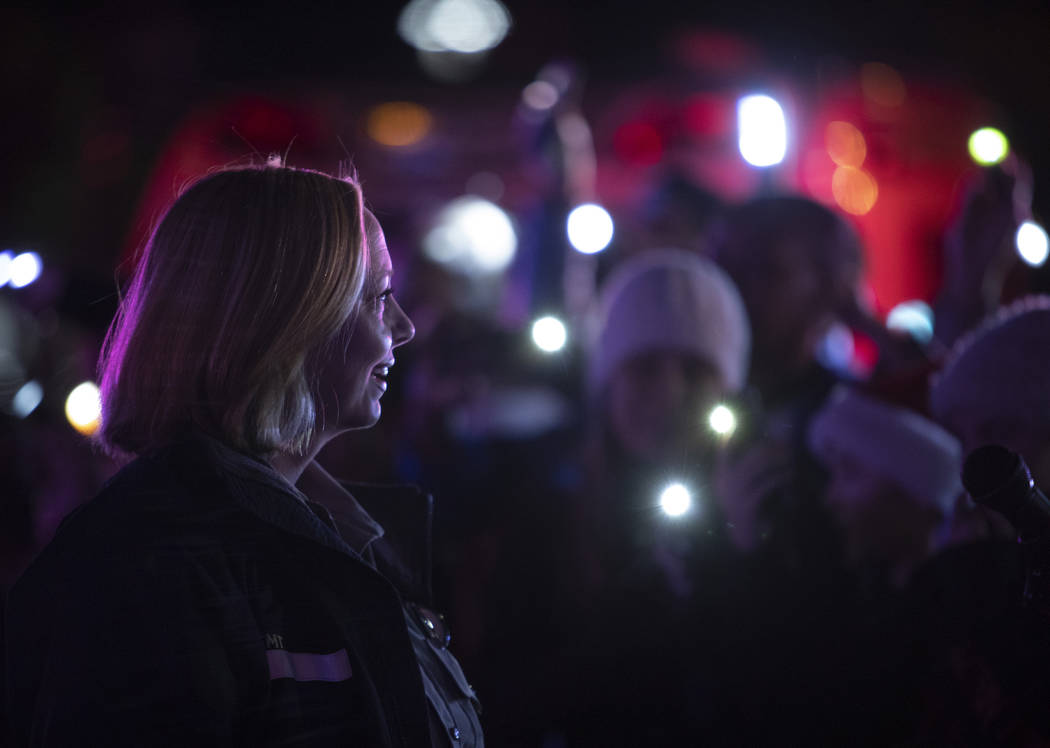 MedicWest paramedic Heather Raasveld, who organized the event, leads the crowd in moving their ...