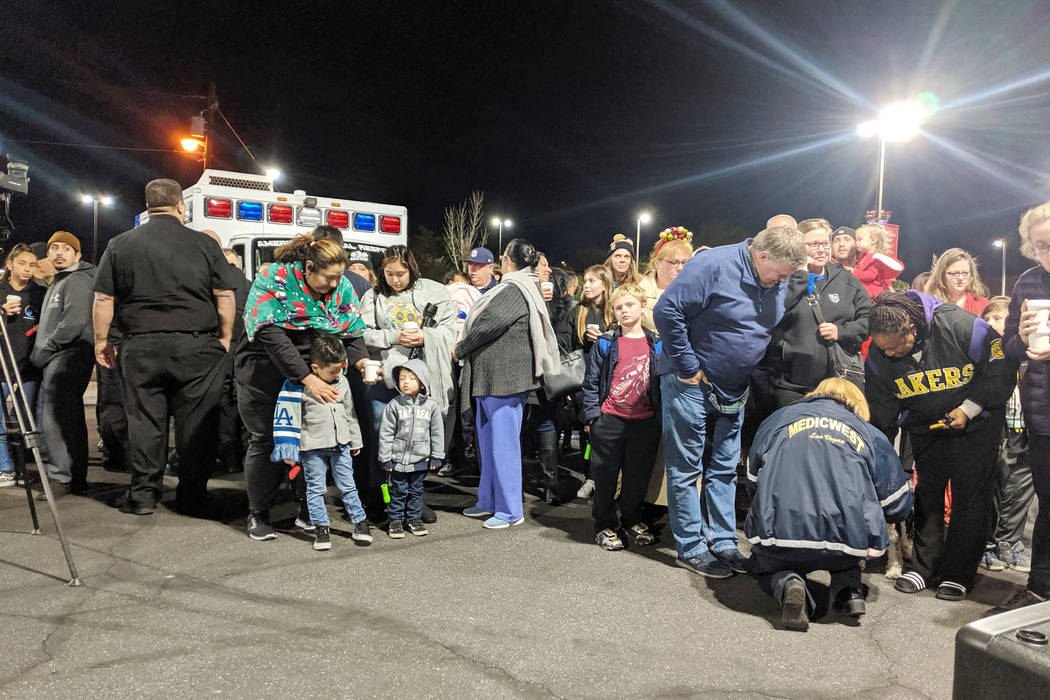 People gather Monday, Dec. 9, 2019, outside of the Children's Hospital at University Med ...