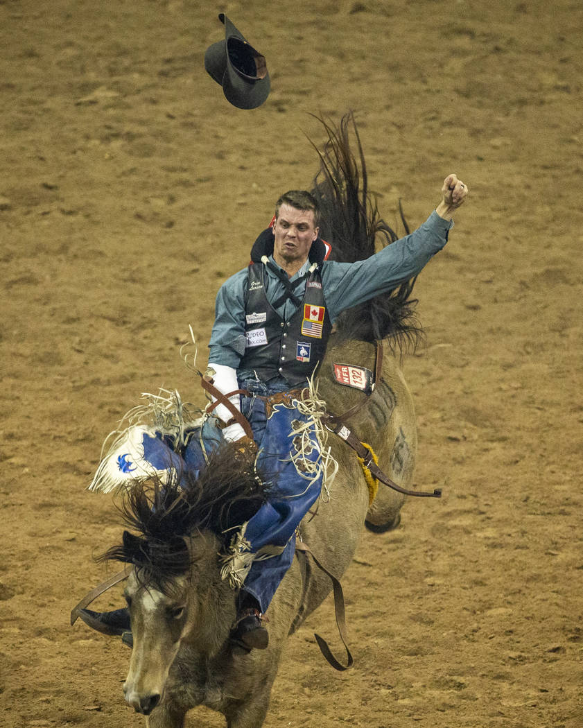 Orin Larsen of Inglis, Manitoba, rides Night Fist for 90.0 points and first place during the fo ...