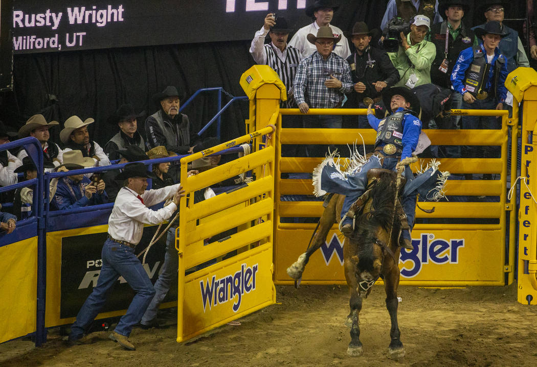 Rusty Wright of Milford, Utah, stays on top of Miss Nancy for a score of 89.5 points to take fi ...