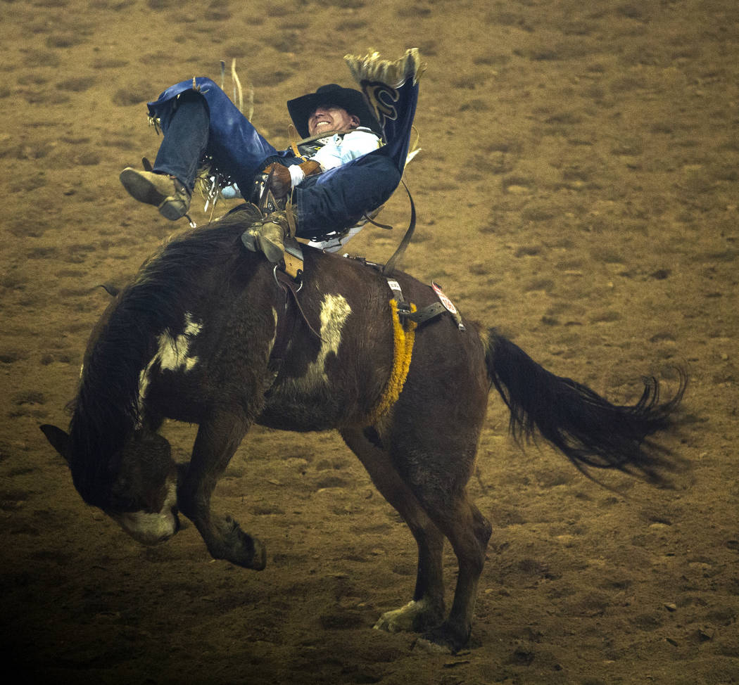 Trenten Montero of Winnemucca, Nev., rides Show Boat during Bareback Riding in the fourth go ro ...