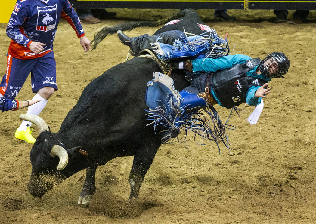 Tyler Bingham of Honeyville, Utah, gets sideways on Night Moves in Bull Riding during the fourt ...