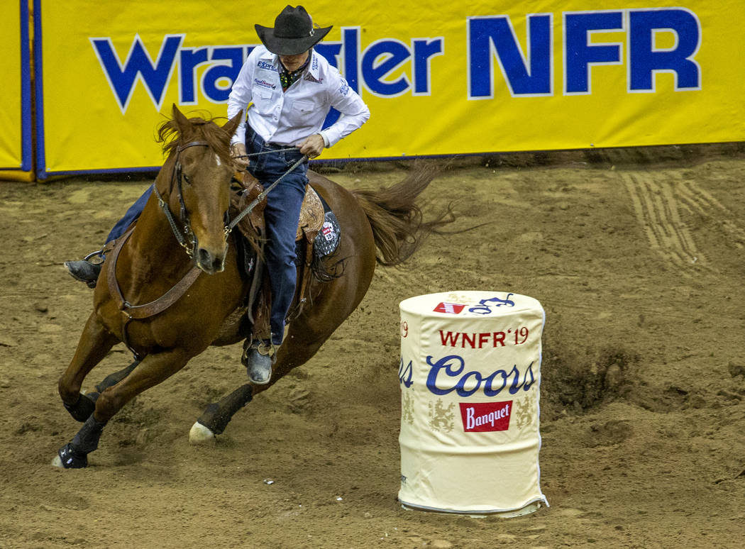 Dona Kay Rule of Minco, Okla., navigates the course in Barrel Racing during the fourth go round ...