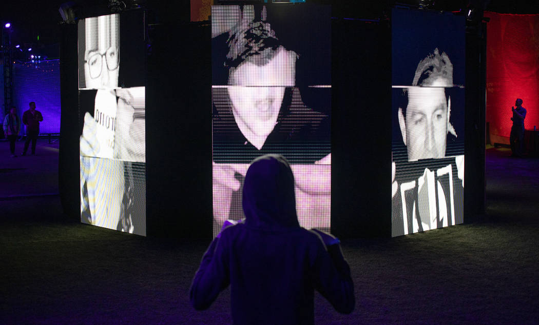 """Luke Yeager, 15, of Las Vegas, views the """"I Am Therefore I Am"""" art installation at In ..."""