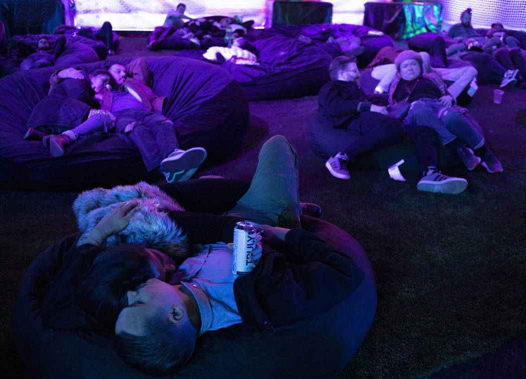 Festival attendees rest in bean bag chairs at Intersect Festival on Friday, Dec. 6, 2019, in La ...