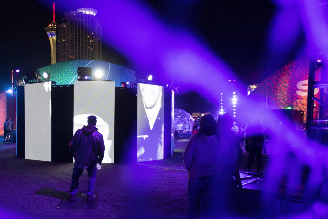"""Festival attendees interact with """"Mixed Mirrors,"""" an art installation at Intersect Fe ..."""