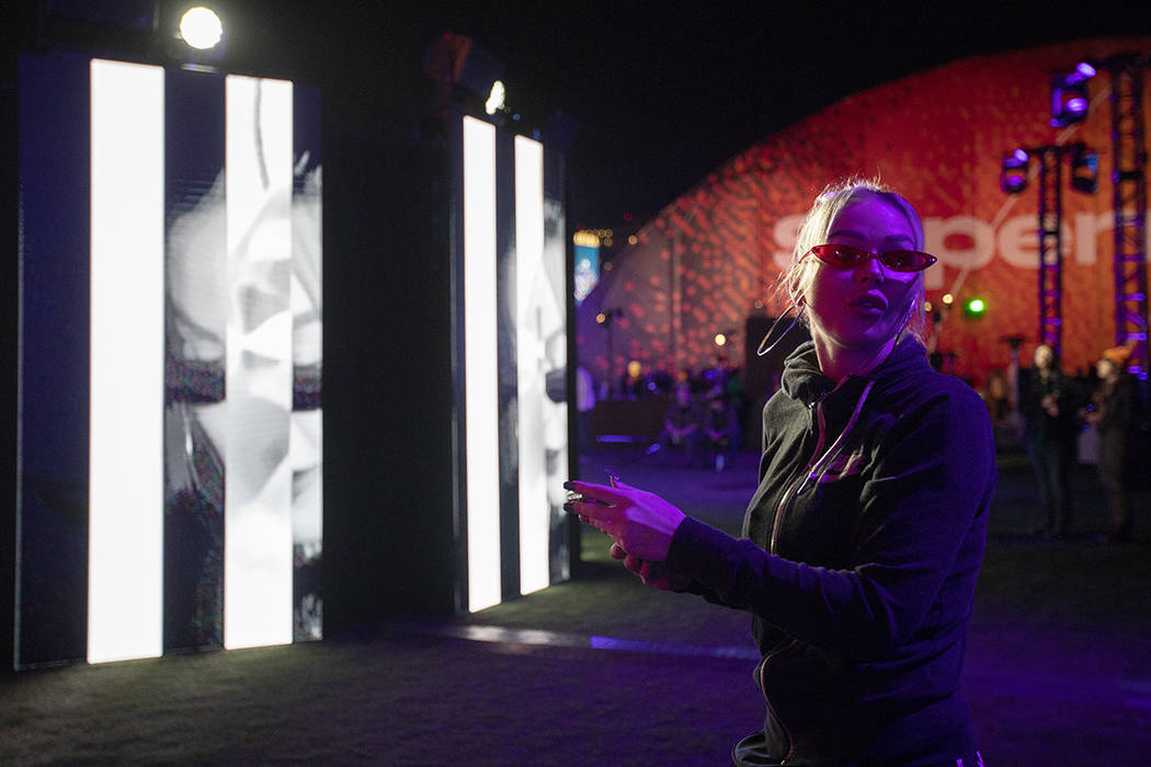 """Amanda Duron of Oregon looks back to tell her friend """"how cool"""" the art installation ..."""